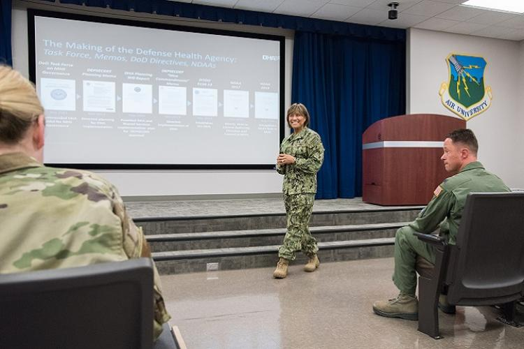 U.S. Navy Vice Adm. Raquel Bono, Defense Health Agency director, speaks with members of the 42nd Medical Group about upcoming changes to military treatment facilities April 12, 2019, at Maxwell Air Force Base, Alabama. The DHA will be responsible for all facilities with respect to budgetary matters, information technology, health care administration and management, administrative policy and procedure and military medical construction. (U.S. Air Force photo by William Birchfield)