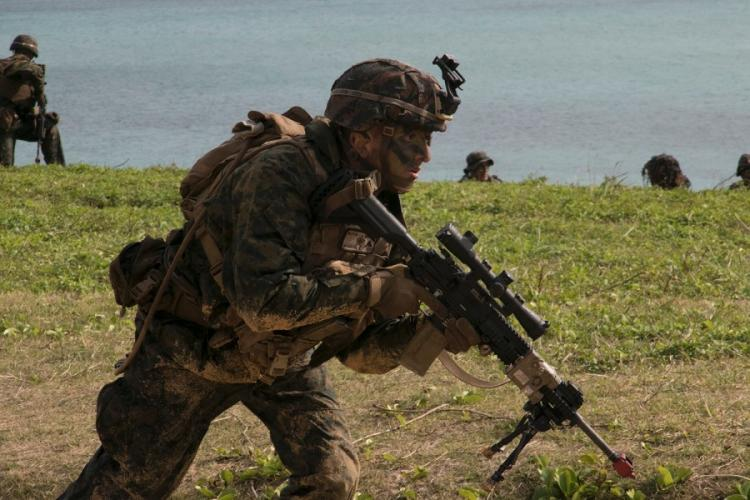 A Marine from the 31st Marine Expeditionary Unit takes part in a raid exercise in Kin, Okinawa, Feb. 9, 2020. MATTHEW BURKE/STARS AND STRIPES