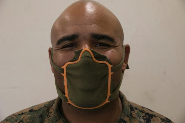 Marine Staff Sgt. Quincy Reynolds of the III Marine Expeditionary Force's 3rd Maintenance Battalion shows off his 3D printed face mask frame at Camp Kinser, Okinawa, Wednesday, April 8, 2020. MATTHEW BURKE/STARS AND STRIPES
