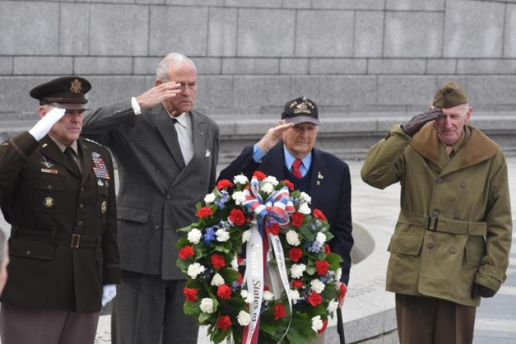 From left: Army Gen. Mark A. Milley, chairman of the Joint Chiefs of Staff; Josiah Bunting III, chairman, Friends of the National World War II Memorial; Ira Rigger, a veteran of the battle of Iwo Jima and other campaigns; and, Harry Miller, a World War II, Korean War and Vietnam War veteran, lay a wreath commemorating the 75th anniversary of the start of the battle of Iwo Jima at the National World War II Memorial in Washington, Feb. 19, 2020. (Photo Credit: David Vergun, DOD)