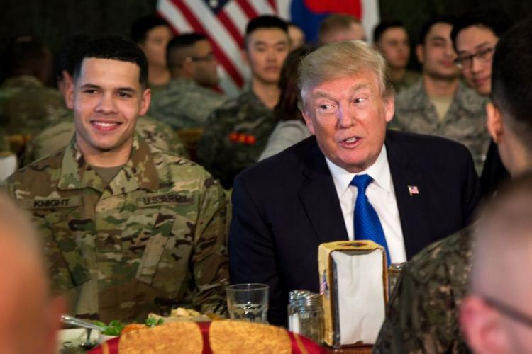 President Donald Trump eats with the troops at Camp Humphreys, South Korea, Tuesday, Nov. 7, 2017.  MARCUS FICHTL/STARS AND STRIPES