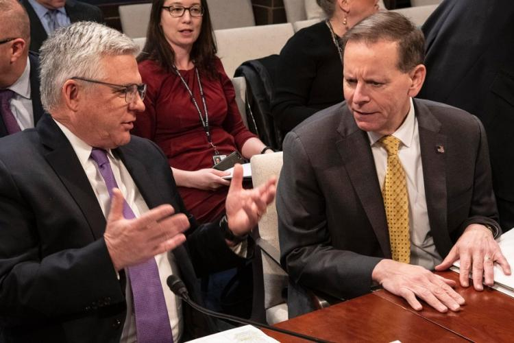 Veterans Health Administration Executive in Charge Dr. Richard Stone, left, talks with VA Under Secretary for Benefits Dr. Paul Lawrence before a House Veterans' Affairs Committee hearing on Capitol Hill, Feb. 27, 2020. JOE GROMELSKI/STARS AND STRIPES