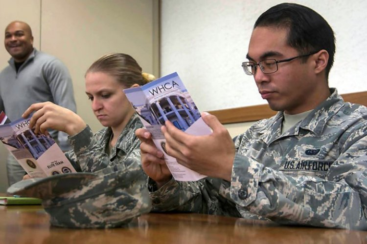 Servicemembers attend a recruiting seminar hosted by the White House Communications Agency at Yokota Air Base, Japan, Monday, Jan. 28, 2019.  THERON GODBOLD/STARS AND STRIPES